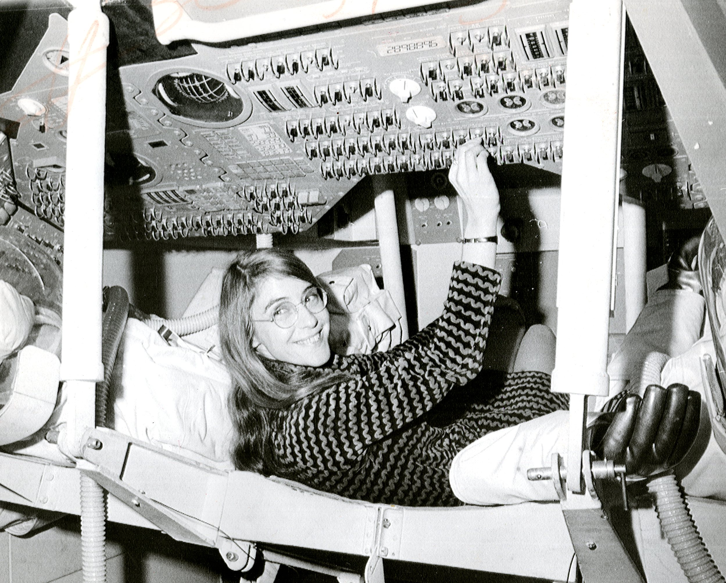 Margaret Hamilton, lead Apollo flight software engineer, in the Apollo Command Module.